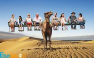 Traveling People Sitting on Camel
