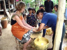 Volunteer takes part in traditional pottery making on the Khmer culture project in Cambodia