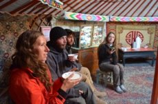 Volunteers drink tea in a Mongolian nomad tent with Projects Abroad